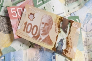 Buy Canadian Dollars (CAD) in the USA. Think about buying it online, at a cash transformer...